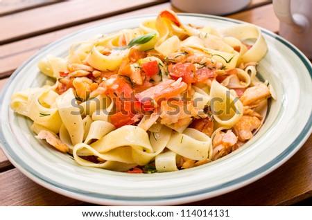 Tagliatelle with salmon and fresh tomato - stock photo