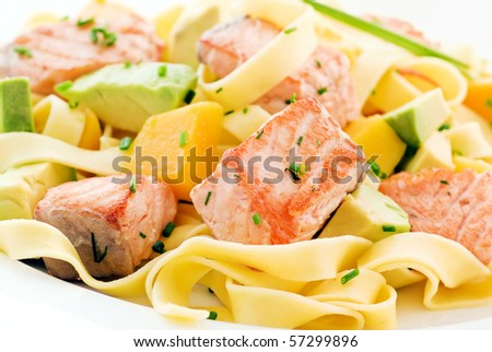 Tagliatelle with Salmon and Fruits - stock photo