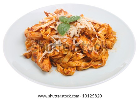 Tagliatelli pasta with chicken pieces in a tomato sauce - stock photo