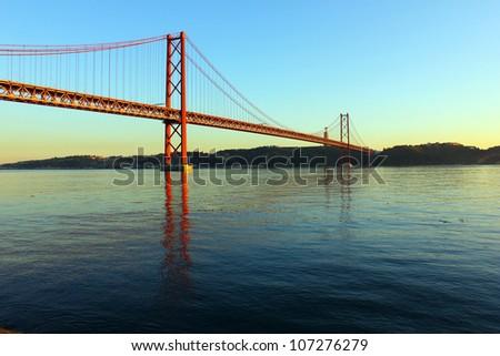 Tagus River and Bridge, Lisbon, Portugal. The Tagus River and the Bridge are two of the most important landmarks of Lisbon. - stock photo