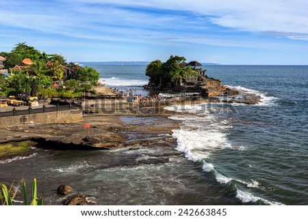 Tahah Lot Temple and ocean waves at sunny day, Bali, Indonesia - stock photo