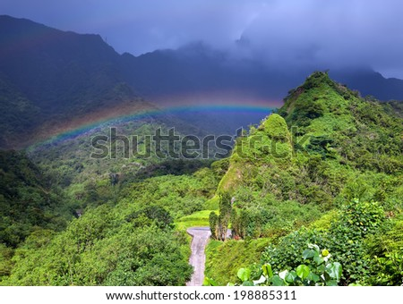 Tahiti. Mountain and rainbow - stock photo