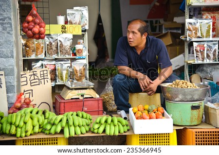 Taichung, Taiwan - Aug 8, 2014: Unidentified seller of fruits, vegetables and other snacks in Taichung. Taichung has a lot of farms and provide different kinds of vegetables and fruits.