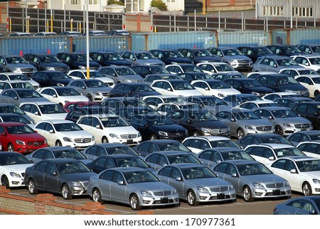 TAICHUNG, TAIWAN -- JANUARY 1, 2014: Luxury car shipments constitute a large part of the business of Taichung Port. Pictured here are newly imported Mercedes Benz sedans. - stock photo