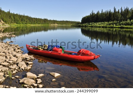 Taiga river Paga, Russia, the Polar Urals. Virgin Komi forests, red boat on the river. - stock photo