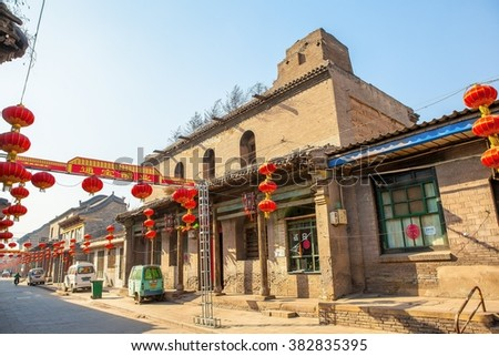 TAIGU,SHANXI/CHINA-Mar10: Taigu old town streets and commercial buildings on Mar10, 2015 in Taigu, Shanxi, China. Between Ming and Qing Dynasty, It was one of finance and business center of the China.
