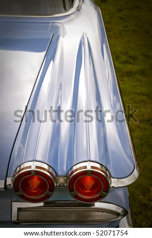 tail lights on a classic fifties american car - stock photo
