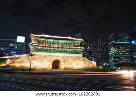 Tail lights streak by Namdaemun Gate in Seoul, South Korea. - stock photo