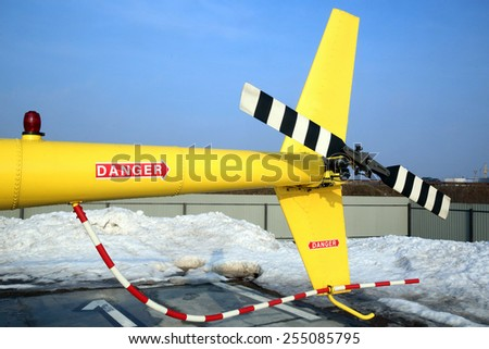 tail of a yellow helicopter - stock photo