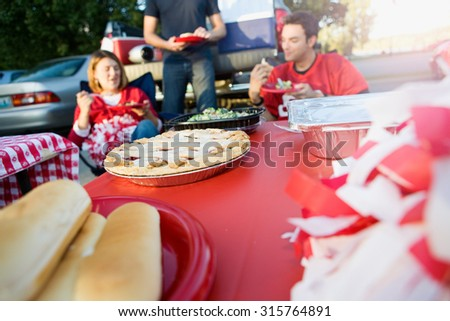 Tailgating: Focus On Apple Pie On Table Of Tailgate Party Food - stock photo