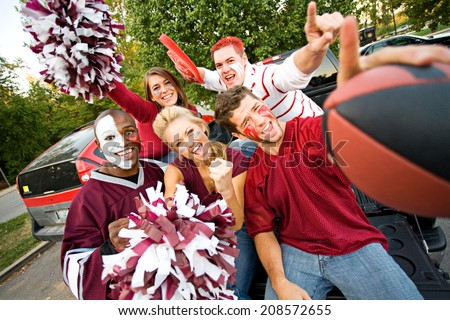 Tailgating: Group Of Excited Fans Cheer For Team - stock photo