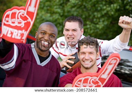 Tailgating: Guy Friends Cheering Their Team On To Victory - stock photo