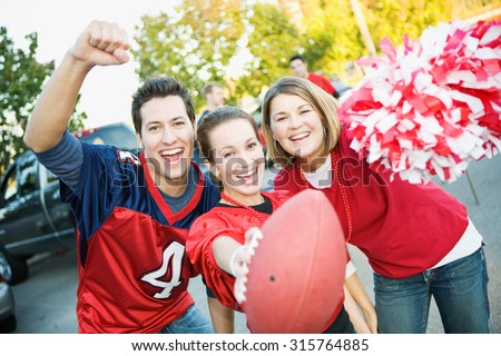 Tailgating: Three Friends Cheer For Favorite Team - stock photo