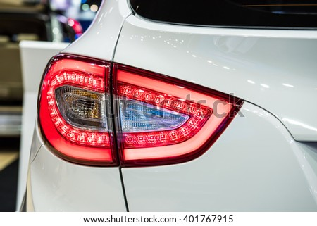Taillight of a modern luxury car, car taillight sports auto detail - stock photo