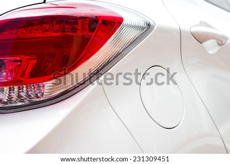 Taillight of a white car - stock photo