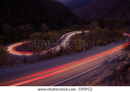 Taillights Driving Down a Canyon