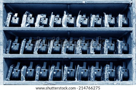 Taillights on warehouse shelves - stock photo
