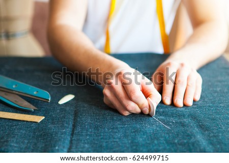 Tailor man working in his tailor shop, Tailoring, close up