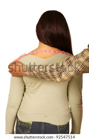 tailor measures the customer back - stock photo