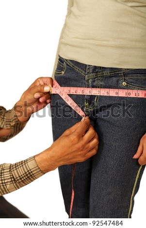 tailor measuring Hip over white background - stock photo