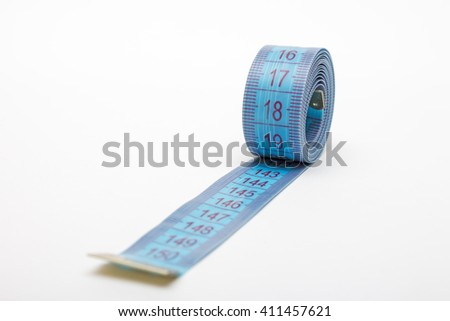 Tailor measuring tape with soft shadow.measurements of length,meter for the tailor,closeup,white background - stock photo
