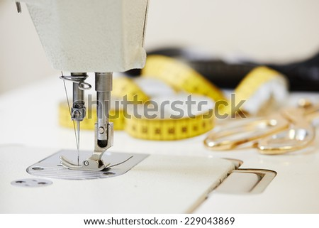 Tailor or sewing set. Cloth, machine, scissors, measure tape - stock photo
