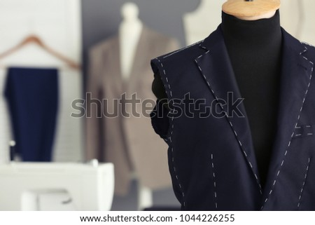 Tailor's mannequin with half-made jacket in atelier