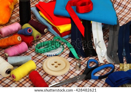 Tailor's tools on bright background