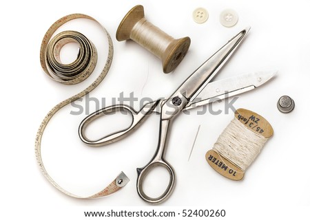 tailor's tools - scissors, measuring tape, thimble, etc. - on white - stock photo