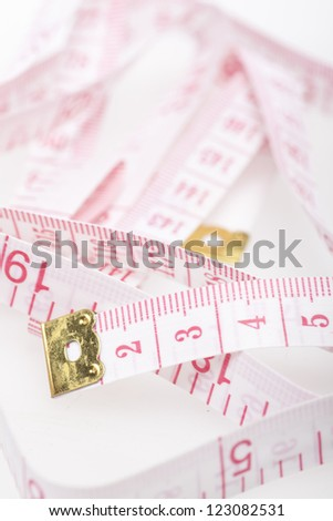 Tailor tape measure - stock photo
