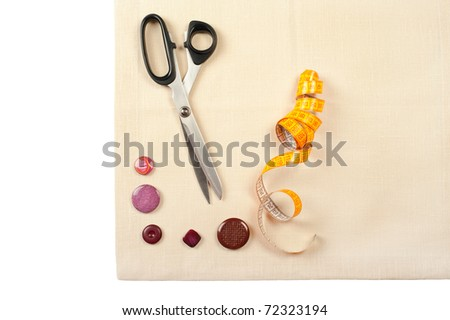 Tailor tools for craft. Set from measuring tape, buttons and scissors on linen canvas - stock photo
