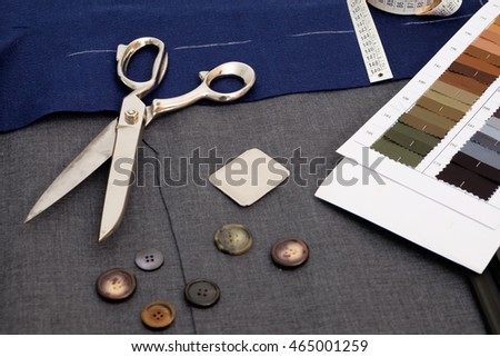 Tailor tools isolated on textile background