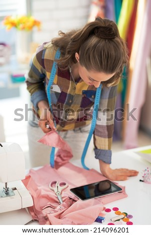 Tailor woman using tablet pc at work