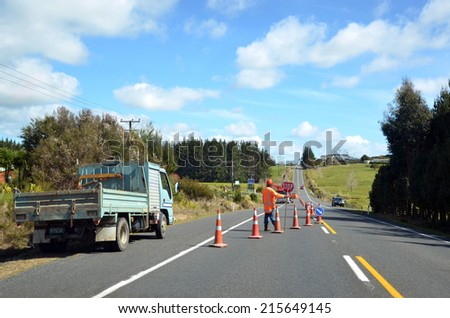 TAIPA, NZ - APR 01 2014:Fulton Hogan roadwork.Fulton Hogan is a large infrastructure construction, roadworks company in NZ and Australasia.In 2013 it's annual operating profit was NZ$96.5 million.