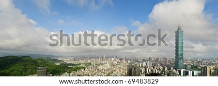 Taipei city skyline under white clouds and blue sky in Taiwan. Horizontal panoramic cityscape. - stock photo