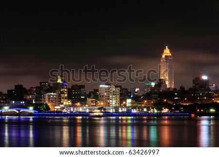 Taipei night scene near the Tanshui River  , Shin Kong Life Tower(SHIN KONG MITSUKOSHI), view of Dadouchen(Tataocheng), a old wharf of Taipei, Taiwan - stock photo