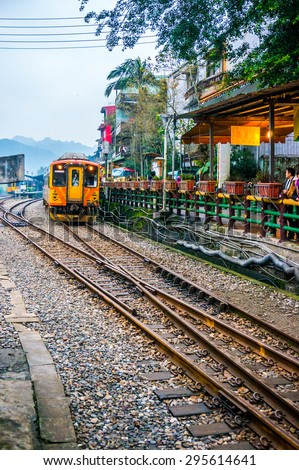 TAIPEI, TAIWAN - DECEMBER 2013 - The train travelling on the Shifen Old Street railroad on Dec 30, 2013. It attracts a large number of visitors each day and is famous for lighting up sky lanterns. - stock photo