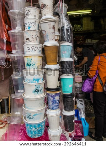 Taipei, Taiwan - 14 February 2015: Different sizes of paper and plastic cups and paper bowls sold on Taiwan traditional market.  - stock photo
