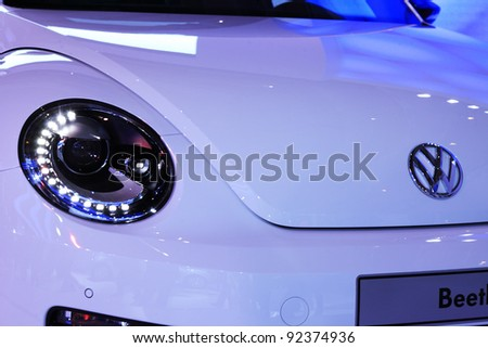 TAIPEI, TAIWAN - JANUARY 1: a 2012 new VW Beetle at the 19th TAIPEI INT'L AUTO SHOW on January 1, 2012 in Taipei, Taiwan - stock photo