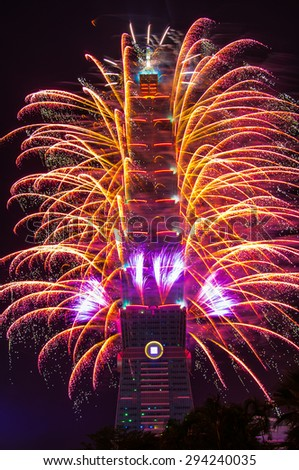 TAIPEI, TAIWAN - JANUARY 2014 - The new year countdown fireworks set ablaze on 1st January 2014 in Taipei 101. A huge crowd gathered to witness the fireworks which went on for more than 2 minutes.  - stock photo
