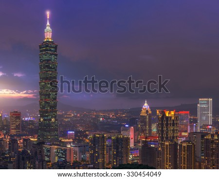 Taipei, Taiwan - Jul 29, 2015 : Beautiful scene of Taipei city at sunset. This photo was taken at the top of Elephant Mountain. You can see the Taipei 101 building standing hight in the scene.