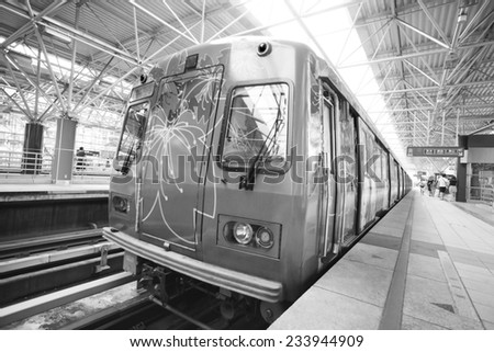 TAIPEI, TAIWAN - JUNE 20: Fast moving MRT on the platform on June 20, 2014 in Taipei. The MRT Subway is one of the best way to go ground Taipei city and new line is still under construction