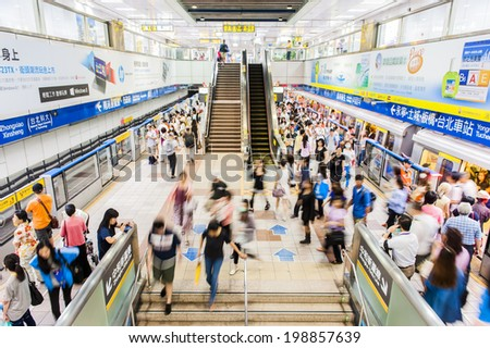 TAIPEI,TAIWAN - JUNE 14: Passengers waiting and ride the MRT, on June 14,2014 in Taipei. The (Metropolitan Rapid Transit) MRT serves 240,000 people daily with 109 stations and 121 km of track. - stock photo