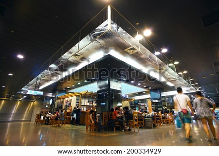 TAIPEI, TAIWAN,  JUNE 23, 2014: Starbucks inside a shopping mall, in Taipei, Taiwan, June 23, 2014.  There are more and more people enjoying coffee  here in Taiwan                               - stock photo