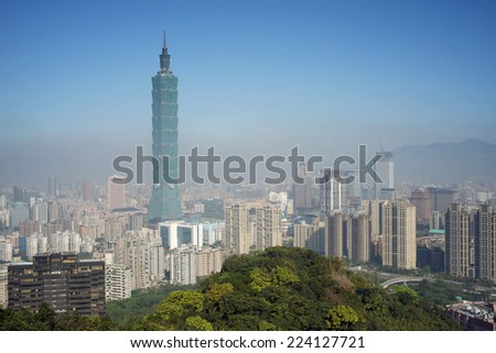 TAIPEI, TAIWAN - June 1: Taipei skyline on June 1, 2014 in Taipei, Taiwan. The city is under sandstorm hit. The air quality is really bad for days. - stock photo