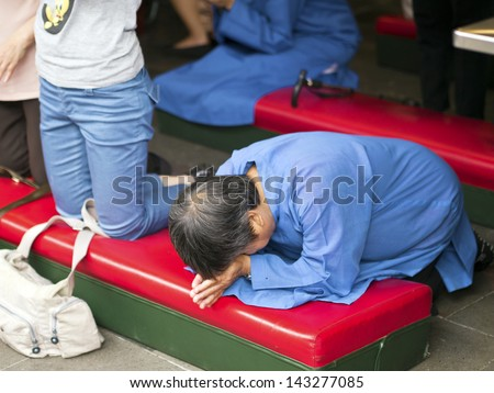 TAIPEI, TAIWAN-JUNE 13,2013:traditional asian praying for chinese god at Hsing Tian Kong on JUNE 13,2013 in Taipei,Taiwan