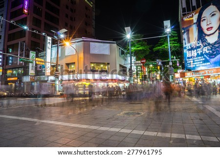 TAIPEI, TAIWAN - May 2 : Locals and tourists walking at the Ximending street market in Taipei, Taiwan on May 2, 2015 .This street is the gathering place for youngster in Taipei. - stock photo