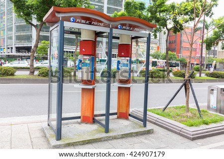 TAIPEI, TAIWAN - MAY 5, 2016: Public telephone booth on sidedwalk Ximendind Taipei, Taiwan.