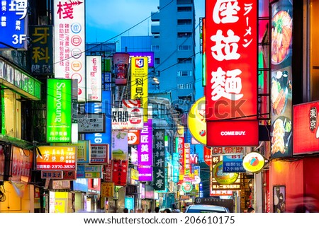 Taipei, Taiwan - May 8, 2014: Sea of neon signs in NanYang St. Taipei central district at night.   - stock photo