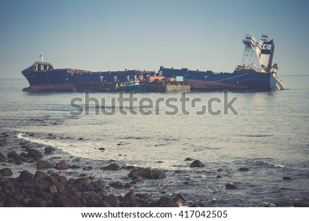 Taipei, Taiwan - 7 May 2016: T.S. LINES Cargo Ship Stranded at North Coast in Shih-Men District   - stock photo